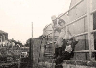 Westridge Farm farmer Bernard Holliday and young children Nigel Holliday and his sister