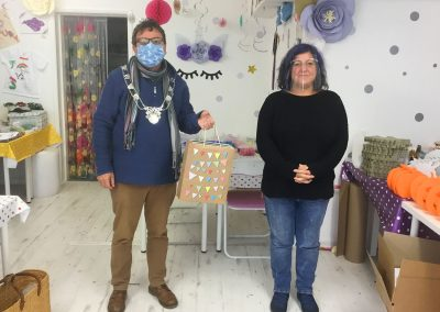 Michael Lilley Ryde Mayor donating £100 to Ryde Network (youth service) at I Love Buttons Ryde High Street Isle of Wight
